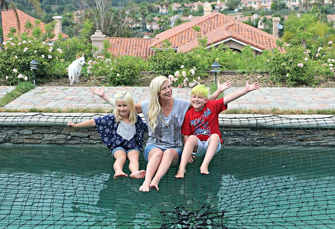 tori spelling chooses katchakid pool safety net