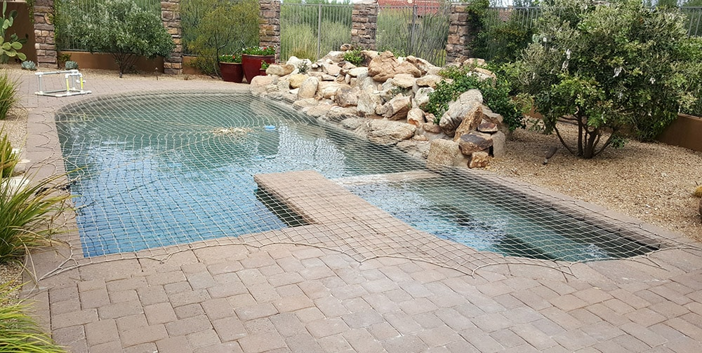 pool cover rock feature